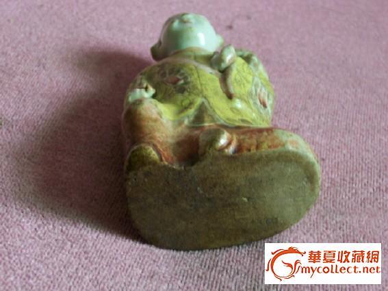 清代黄地粉彩童子瓷雕像图片