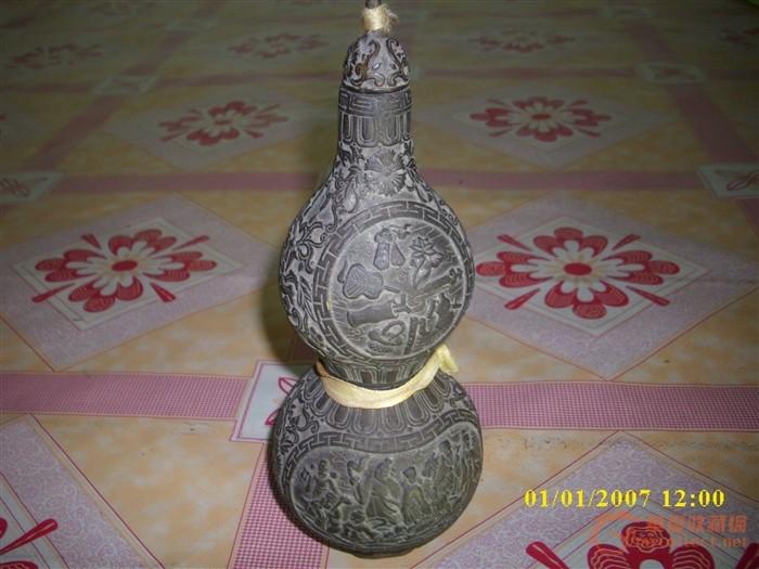 康熙御制八仙过海纹铜葫芦瓶